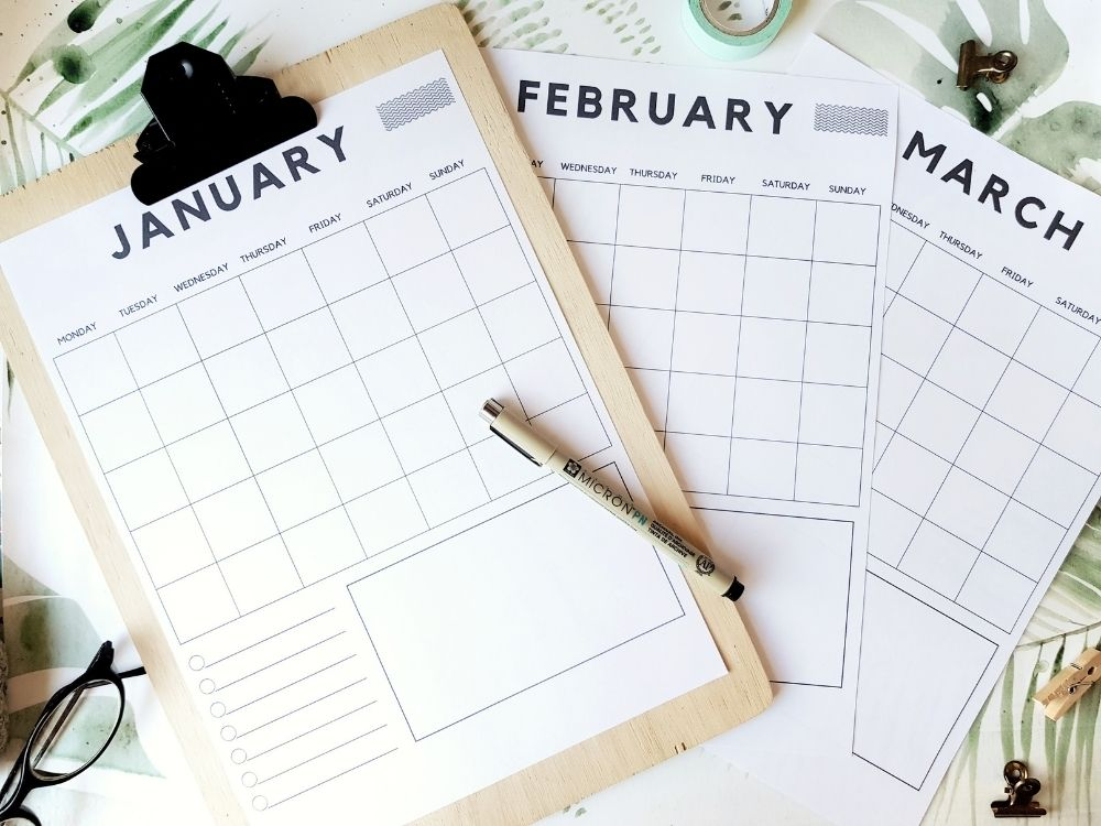 blank monthly calendar with notes